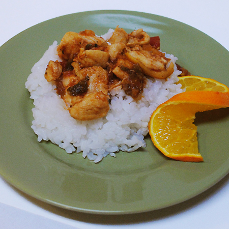 picture of carribean chicken over rice