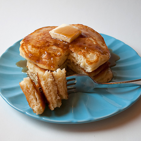 picture of stack and bite of fluffy buttermilk pancakes